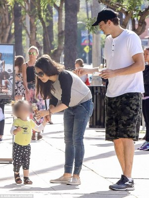 Fun in the sun: Ashton Kutcher and Mila Kunis shared their ice cream with their daughter Wyatt as they enjoyed a family outing in the Sherman Oaks neighborhood of Los Angeles on Sunday