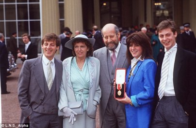 Clement Freud, centre, pictured receiving an award at Buckingham Palace along with his family in 1987