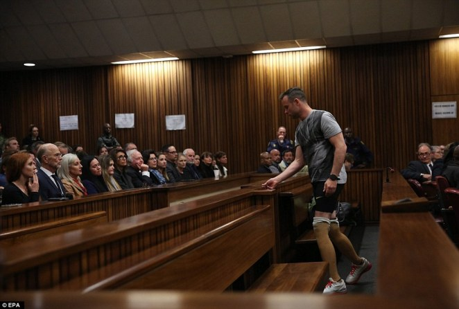 Pistorius prepares to walk across the courtroom without his prosthetic legs during the third day of the sentencing hearing for murder
