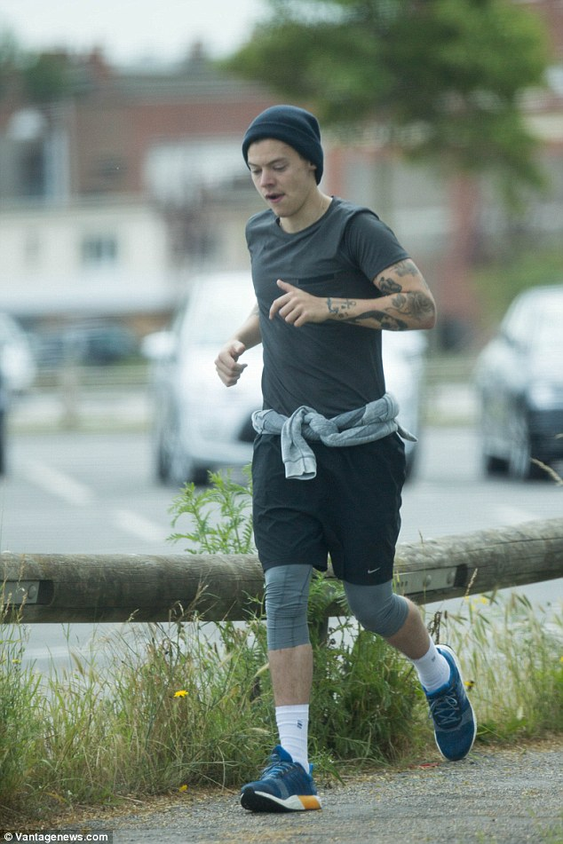 Harry Styles Goes For A Jog With His Bodyguards In Dunkirk