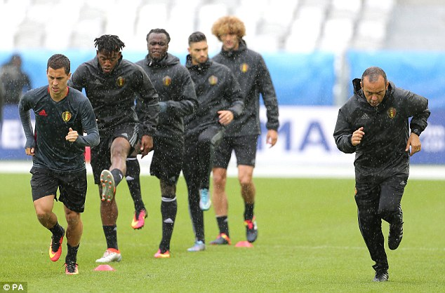 Eden Hazard (far left) and other Belgian players are pictured training in the rain in Bordeaux yesterday ahead of the game with Ireland today. Terrorists are thought to have been planning an attack during the game