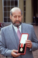 Sir Clement Freud receiving his honour