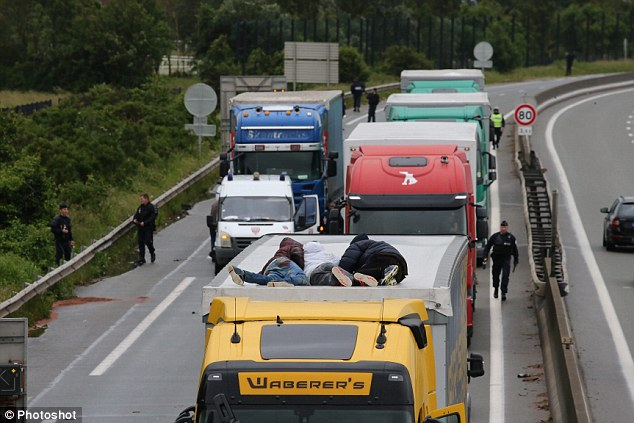 People caught up in the disturbance said cars were being 'stoned' by migrants as they sat in traffic unable to move