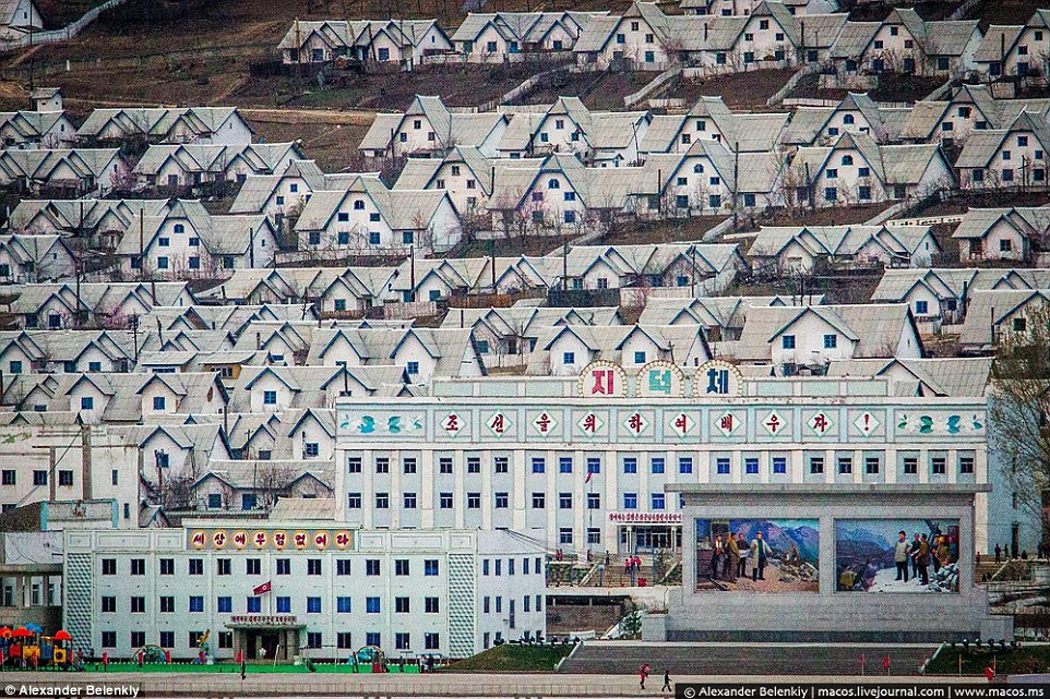 Show town: This stunningly decorated residential complex, with huge colourful murals depicting North Korean heroism, was built to show off, and a childrens' playground takes pride of place in front of the main building, bottom left
