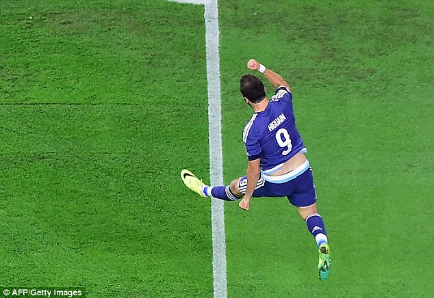 The 28-year-old punches the air with delight after scoring for his country during Tuesday's semi-final