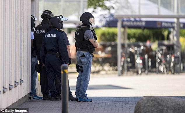 Elite SEK police commandos were helicoptered to the scene before storming the cinema
