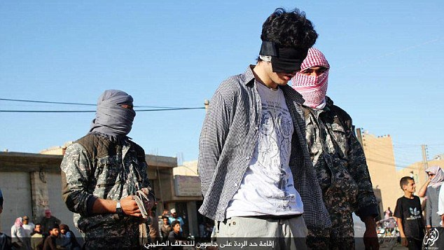 ISIS militants blindfolded the man and handcuffed him before he was walked over to be executed