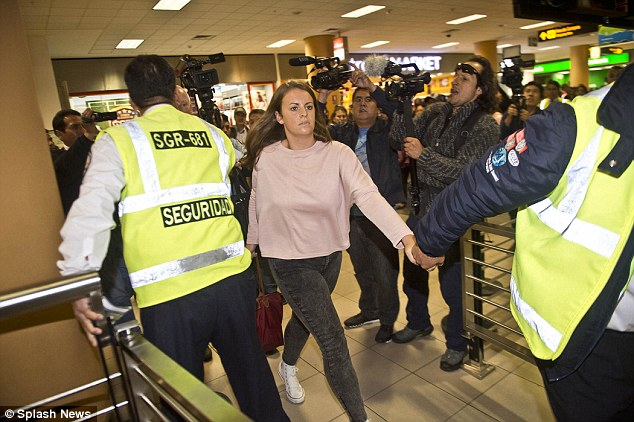 The footage later shows the scale of the drugs haul ¿ more than 24 lb of cocaine concealed inside packs of Quaker's porridge, some jelly mixture and other foil packages. Pictured, Reid on her way home to Scotland