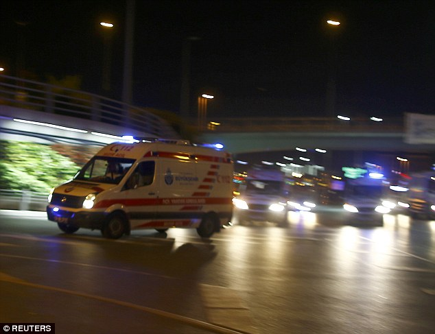 Ambulances rush to the airport after the blasts this evening, to help the at least 40 wounded in the blast