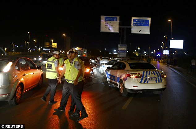 A witness told broadcaster CNN Turk that gunfire was heard from the direction of the car park at the airport, which is the largest in Turkey. Pictured, emergency services at the airport