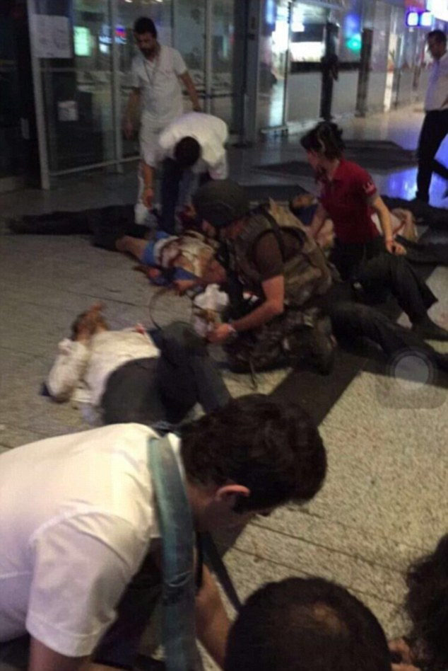 Paramedics at the scene help the 40 wounded at the airport, with at least 10 people reported to have died