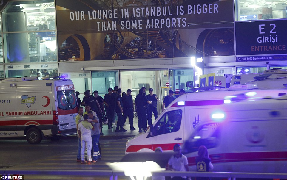 Police officers and ambulance crews outside the international arrivals terminal, which was struck in what officials say was a terror attack