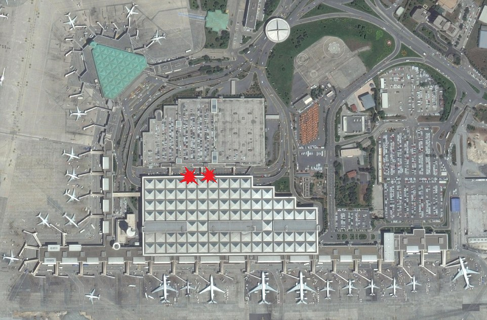 An aerial view of the airport shows where the suicide bombers are believed to have detonated their explosives, at the entrance to the international arrivals terminal