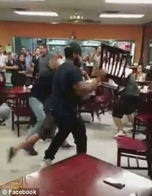 Isael Rojas filmed the clash between customers at the restaurant – and posted the whole thing on Facebook