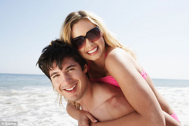 Women are more attracted to men who surround themselves with other attractive women, a study found (file image)
