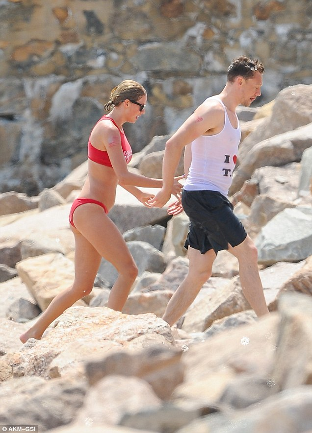 PDA time: Taylor and her new boyfriend, English actor Tom Hiddleston, managed to sneak in some PDA during Sunday's festivities