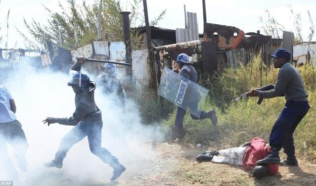Image result for mugabe police beatings