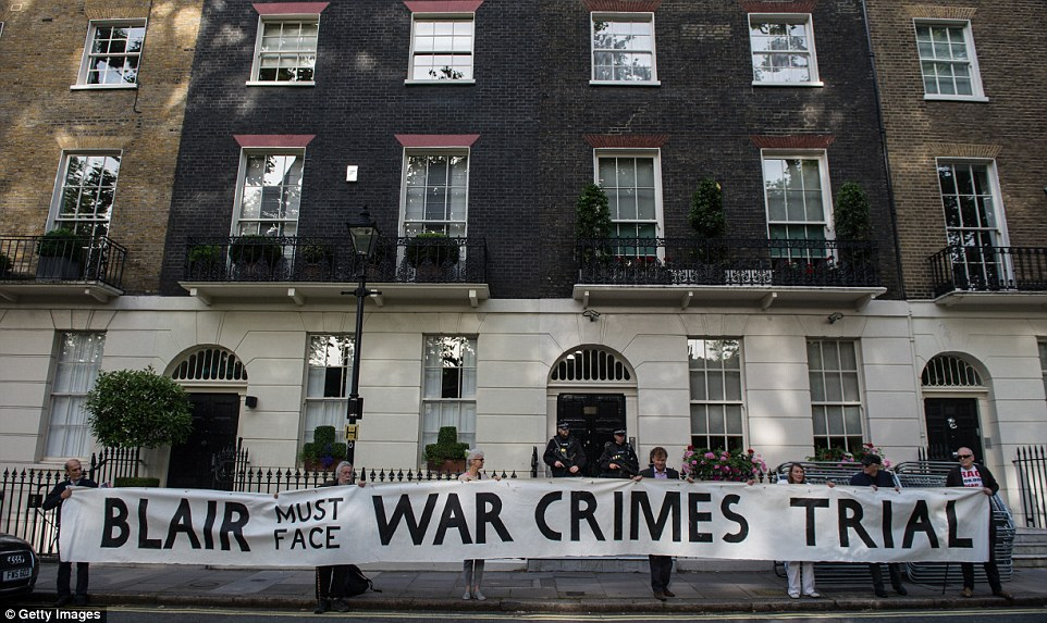 Anger: Protestors unfurled a giant banner outside Tony Blair's central London home today calling for him to face a criminal trial