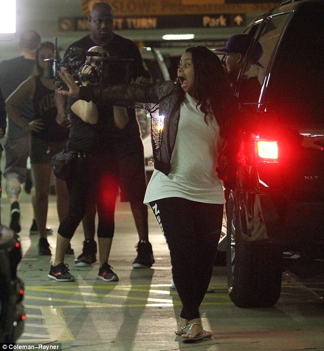 Rolling: A cameras crew can be seen behind Chyna as she went out in Washington DC on Saturday