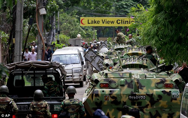 angladesh security personnel stand on top of armored vehicles after militants took hostages at a restaurant popular with foreigners in Dhaka, Bangladesh, on Saturday