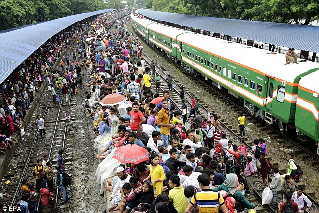 People wait to board trains as they travel to their villages ahead of the Eid Al-Fitr celebrations at the Airport Railway Station in Dhaka, Bangladesh, hours before the attack in Kishoreganj