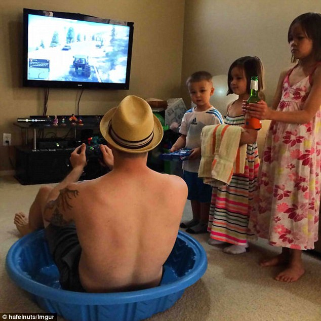 'This is how I wanted to spend father's day': A dad has his ideal father's day - sitting in a tub playing video games while his children wait on him with beer and towels