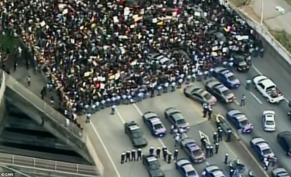 Thousands of protesters have blocked a highway in Atlanta as they march through the city to demonstrate against police brutality