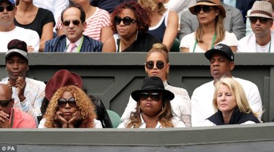 Anxious: Serena's mum (bottom left) looked fully focused as she held her face in her arms