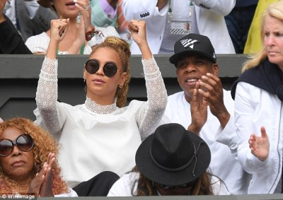 Cheering her on: Serena's sensational play put on a smile on Jay's face