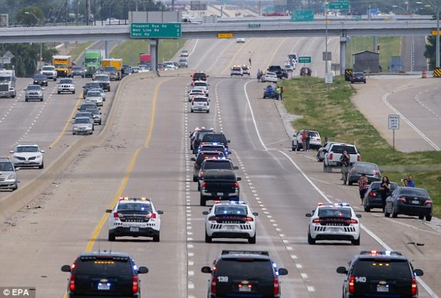 Hundreds of police officers lined roads and bridges to salute Brent Thompson, one of the cops killed in the Dallas massacre, as his body was driven back to his home town ahead of his funeral
