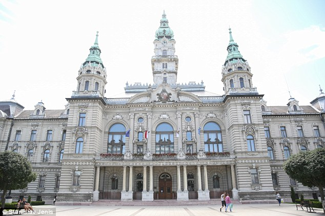 Vote: Hungary will be holding a referendum on October 2 to decide whether or not to accept the Brussels refugee quota, and polls suggest 75 per cent will reject the scheme. Pictured,  Baroque style town hall in Gyor