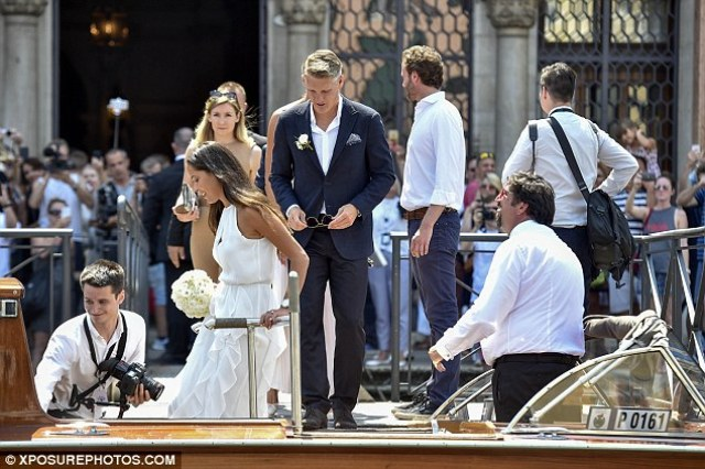 The married couple board a boat as they prepare to sail across the Venice canal on Tuesday