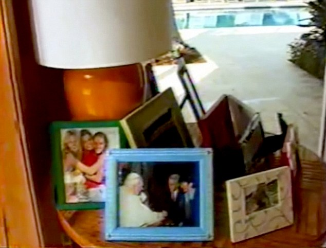 In another non-risque photo in the home, Epstein and another person can be seen meeting Pope John Paul II
