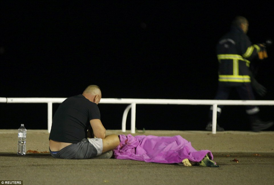 Stunned eyewitnesses prayed over the bodies of their friends and relatives who were killed in the Bastille Day massacre