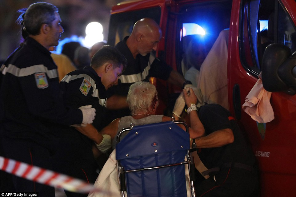 Emergency services helped wounded survivors into a fleet of ambulances to evacuate them from the scene for treatment