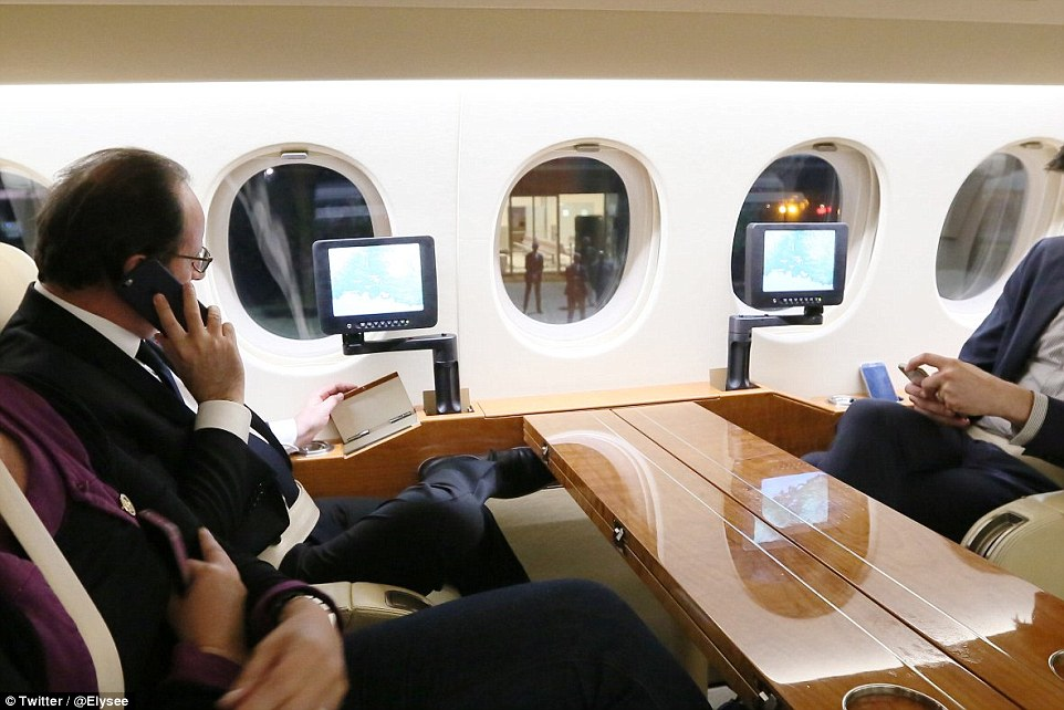 President Hollande, pictured, was updated on the massacre as he flew to the crisis nerve centre last night with PM Manuel Valls, right