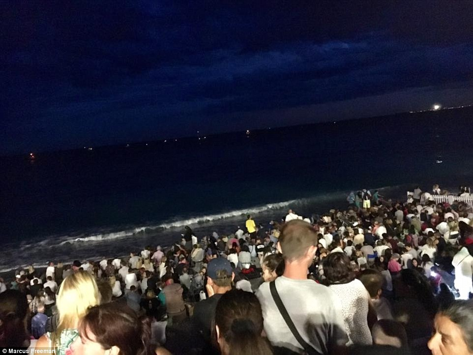 Thousands of people stood on the beach waiting for the fireworks display to celebrate the storming of the Bastille