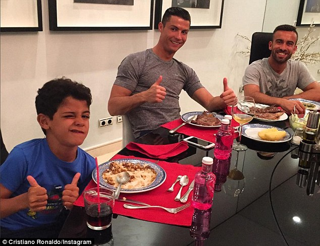 The ex-Manchester United star pictured with his sonCristiano Ronaldo Jnr (left) and friendRicardo Regufe