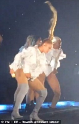 The plait can be seen whipping around the singer, 34, as she dances during the show in Germany on Tuesday night