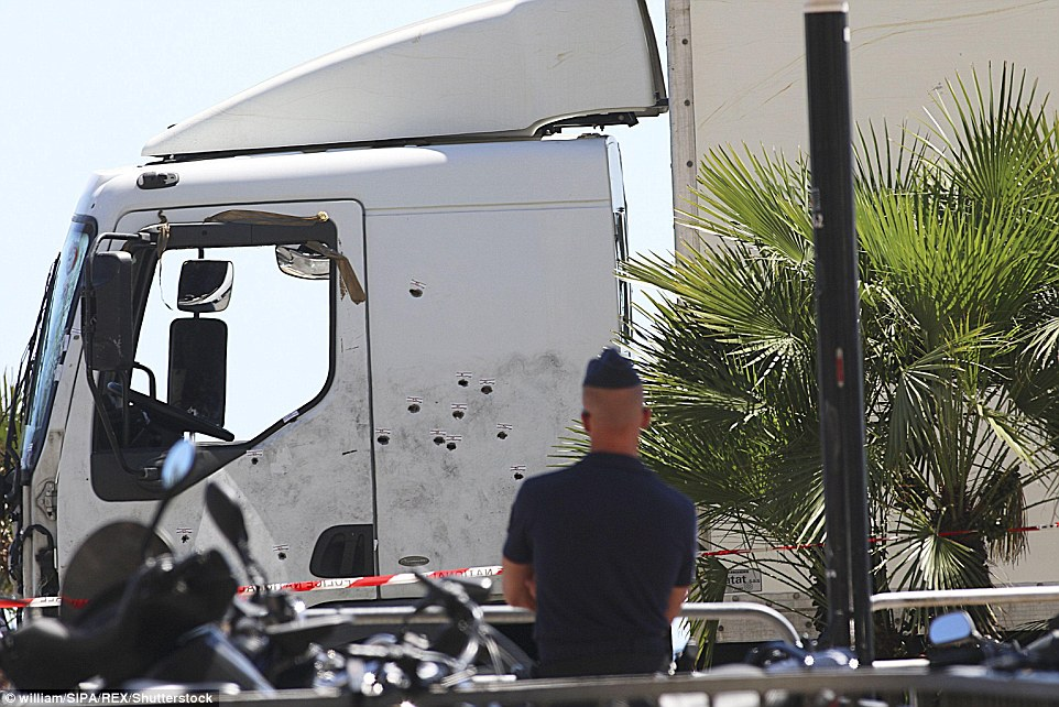 End: The police said today thatFrench Tunisian Mohamed Lahouaiej Bouhlel died in the passenger seat of this 19-tonne truck after a shoot-out