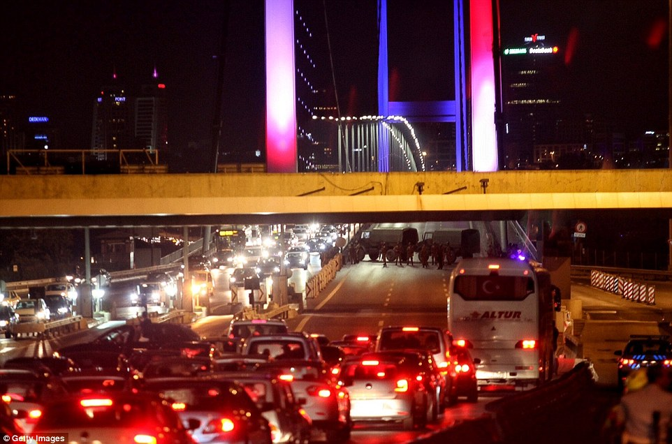 Soldiers blocked Istanbul's Bosphorus Bridge which was lit  in the French colours in solidarity with Nice