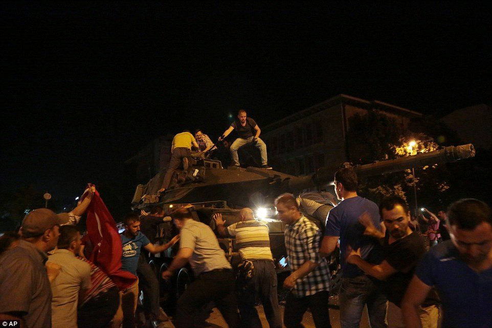 Supporters of Erdogan clambered on top of a tank in Ankara to prevent it from taking a strategic position in the city