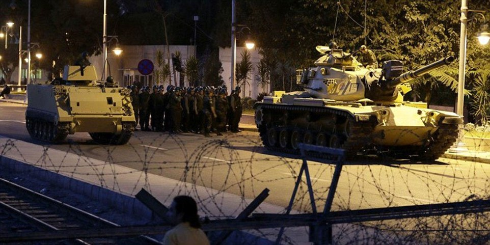Tanks and armoured personnel carriers protected barricades with dozens of infantry troops in support of the coup