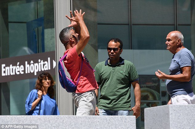 Tahar Mejri, who lost his wife during the deadly Nice attack that left 84 dead on Bastille day, yells in front of the Pasteur hospital in the French riviera town of Nice after he found out about  the death of his son