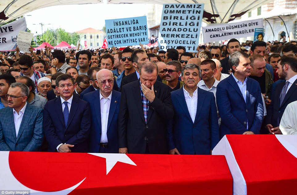 Turkish President Recep Tayyip Erdogan, centre, has vowed to purge all state institutions of supporters of an Islamist cleric his government blames for Friday's failed coup attempt