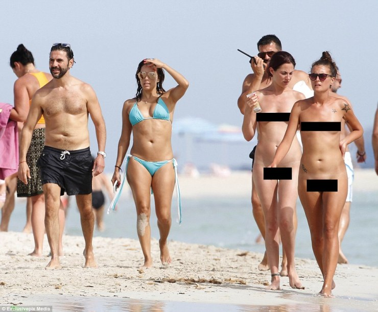 Just realised, Eva? The 41-year-old Desperate Housewife star and media mogul Jose looked around the busy beach as they realised they were among the only ones wearing swimming costumes - and bumped into two totally naked women