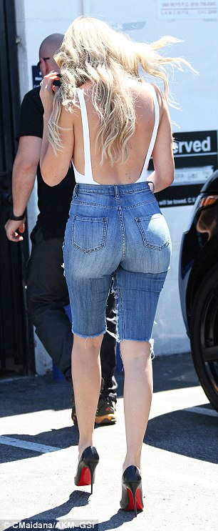 How low can you go: Khloe showed off a fair amount of skin in front and in back