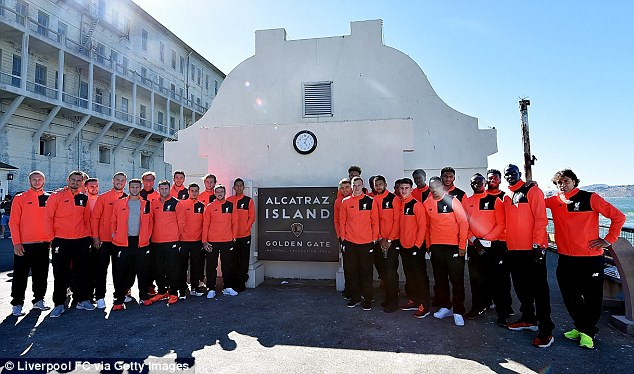 Liverpool manager Jurgen Klopp and his players pose for a photo during their trip to Alcatraz on Thursday