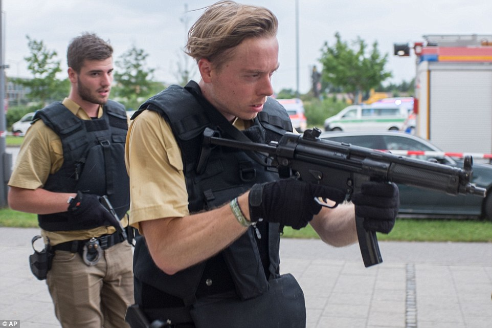 Armed policemen arrive at a shopping centre in which a shooting was reported in Munich, southern Germany