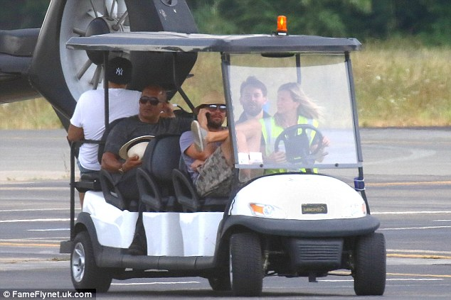 DiCaprio was then pictured minutes later talking on the phone and sucking on a vaper, as he was carted across the runway by in a buggy.